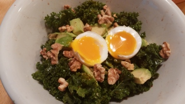 Breakfast: kale salad with toasted walnuts, avocado and soft-boiled duck eggs
